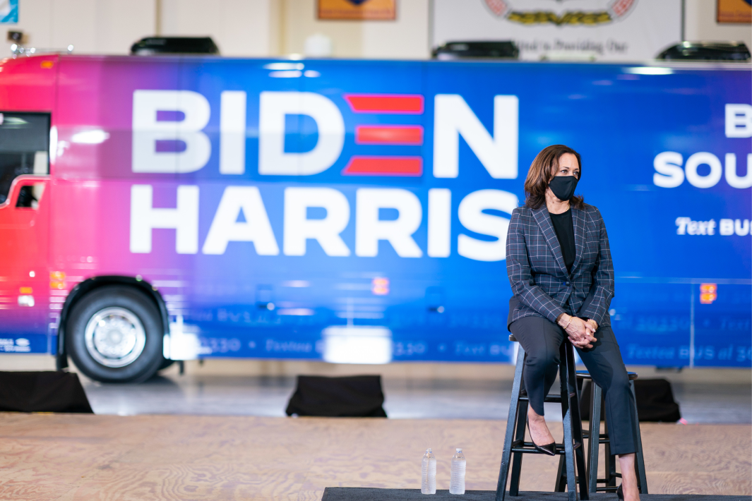 VP Kamala Harris sitting in front of Biden/Harris bus